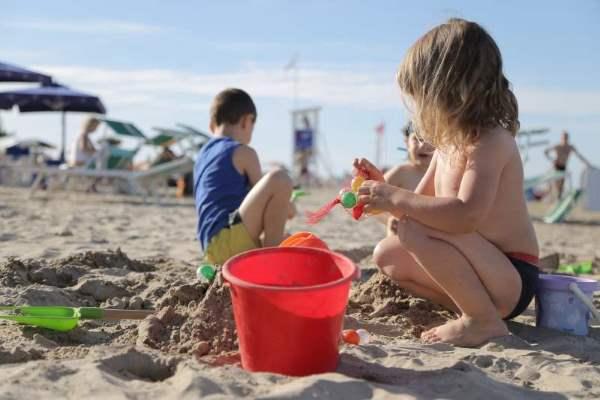 Bandiera verde, bambini in spiaggia
